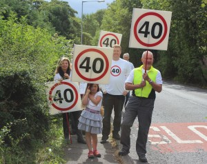Greg (on the right in the hi-vis jacket) campaigning for lower speed limits on Turton Road